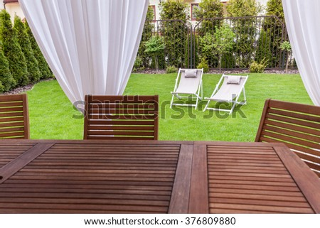 Beautiful wooden furnitures on a terrace