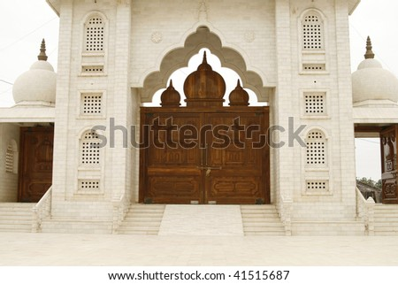 Beautiful wooden gate to a holy temple of Jaigurudeo in India, Rajasthan region