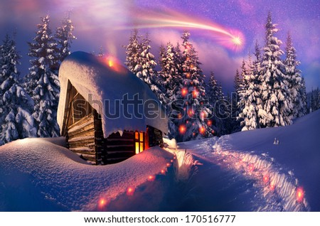 Beautiful wooden house as Santa Claus, with glowing window is located at the beginning lifting of the alpine heights. Climbers spend the night here and in the morning go to the top to meet the new day
