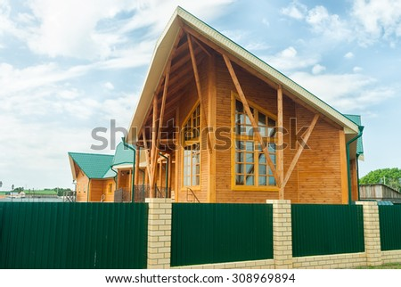 Beautiful wooden house for resting with verandah - stock photo