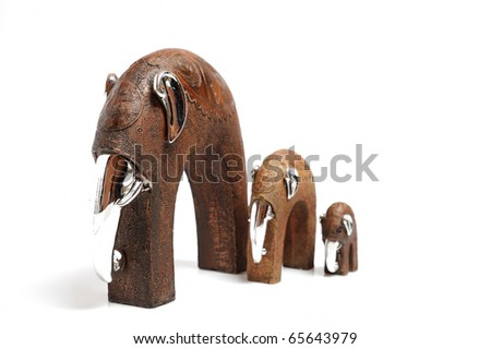 Beautiful wooden statue of elephant family . isolated on white background - stock photo