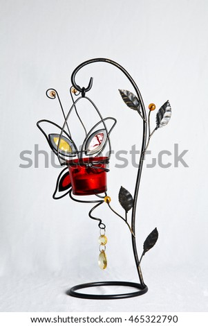 Beautiful wrought iron Candlestick on white background.