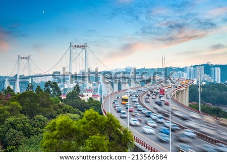 beautiful xiamen haicang bridge in sunset ,busy traffic in the rush hour