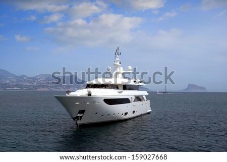 Beautiful yacht anchored in the coast of Altea; Alicante. - stock photo