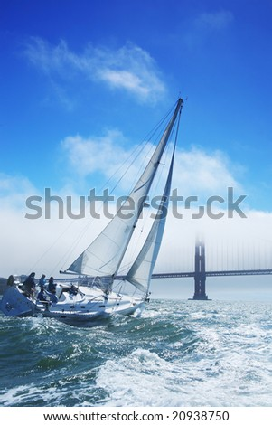 Beautiful yacht in San Francisco bay, Golden Gate bridge on the horizon. California, USA - stock photo