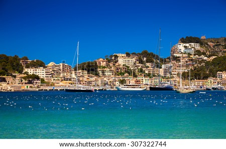 beautiful yachts and houses in the harbour of Port de Soller, Mallorca, Spain - stock photo