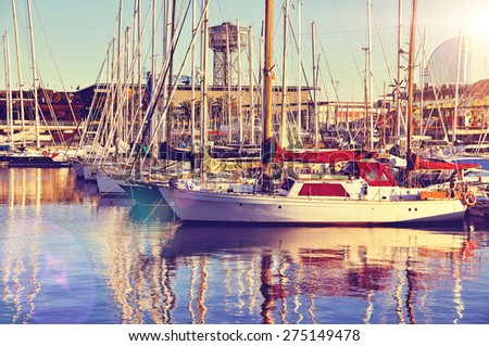 Beautiful Yachts at the Port of Barcelona Harbor, Spain at the sunset. Toned photo. - stock photo