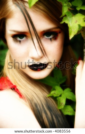 Beautiful 14 year old teen in goth make-up outside. - stock photo