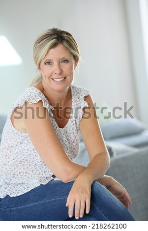 Beautiful 40-year old woman at home - stock photo
