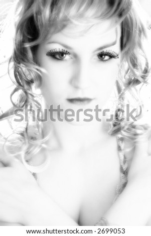 Beautiful 19 year old woman in artistic make-up in black and white.