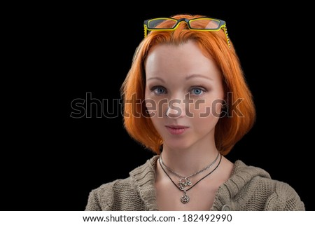 Beautiful yong woman  with red hair isolated on black - stock photo