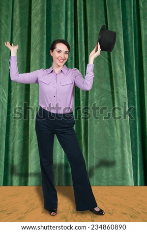 Beautiful young actress dancer wearing a top hat - stock photo