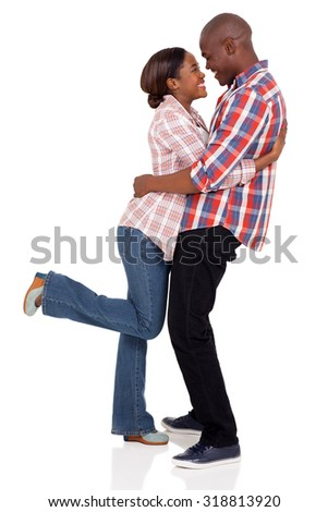 beautiful young african american couple embracing