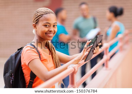 beautiful young african american university student using tablet computer