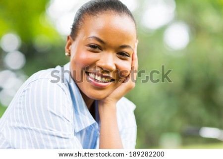 beautiful young african american woman outdoors - stock photo