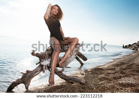 Beautiful young African American woman posing outdoor. - stock photo