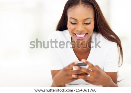 beautiful young african american woman using smart phone - stock photo