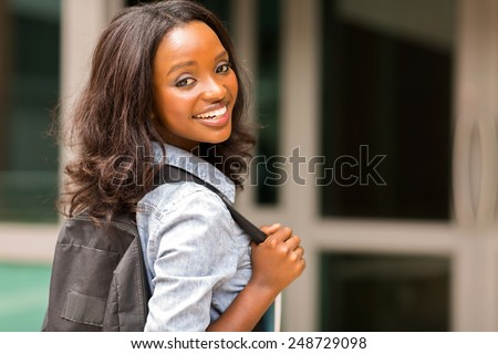 beautiful young african college girl carrying backpack - stock photo