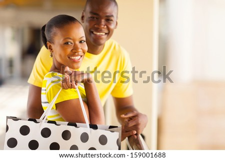 beautiful young african couple with shopping bag - stock photo