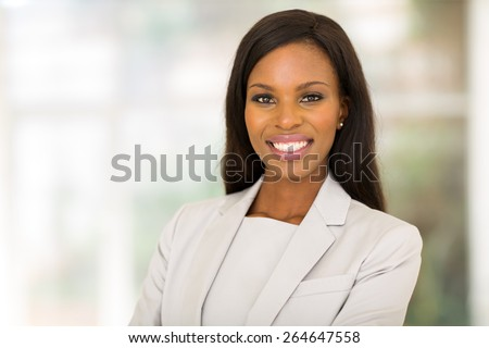 beautiful young african entrepreneur in modern office - stock photo