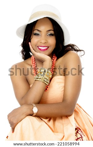Beautiful Young African Female Model, Sitting,  Isolated on White - stock photo