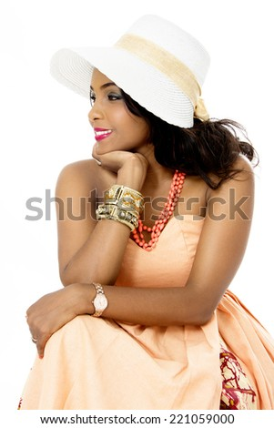 Beautiful Young African Female Model, Sitting, Looking Sideways, Isolated on White - stock photo