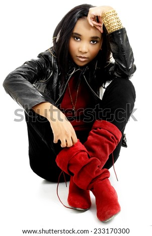 Beautiful Young African Woman Dressed in Red and Black, Isolated on White Background - stock photo