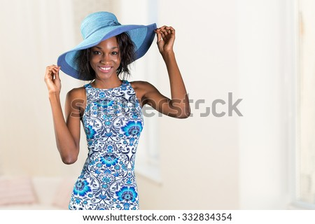 Beautiful young african woman in a hat - stock photo