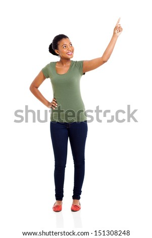 beautiful young african woman pointing up on white background - stock photo