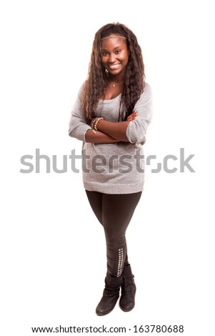 Beautiful young african woman posing isolated over white - stock photo