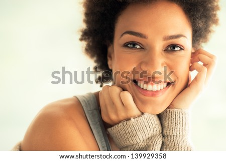 Beautiful young African woman smiling. - stock photo