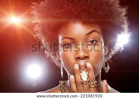 Beautiful young African woman with afro hairstyle - stock photo