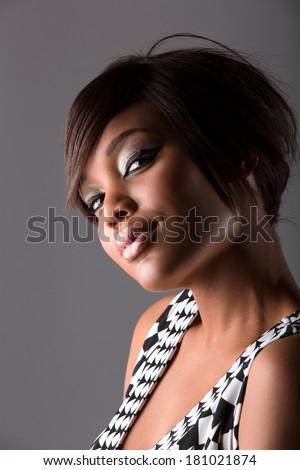 beautiful young african woman with fringe and long hair hairstyle on studio background - stock photo