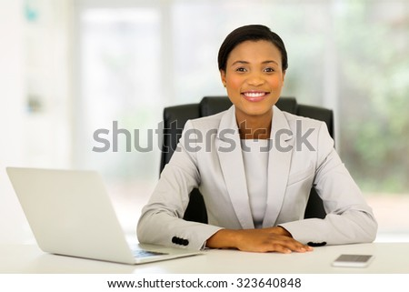beautiful young afro american businesswoman relaxing in office - stock photo