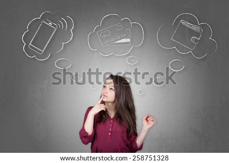 Beautiful young and pretty woman choosing a payment method between smartphone, credit or debit card and money (cash) - stock photo