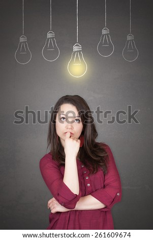 Beautiful young and pretty woman thinking (have no idea) in front of light idea bulbs concept - stock photo