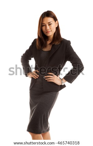 Beautiful young Asian business woman isolated on white background.