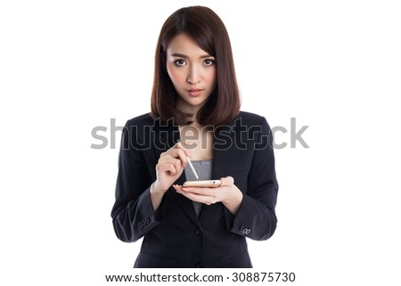 Beautiful young asian business woman typing with stylus on device or smartphone, isolated on white background - stock photo
