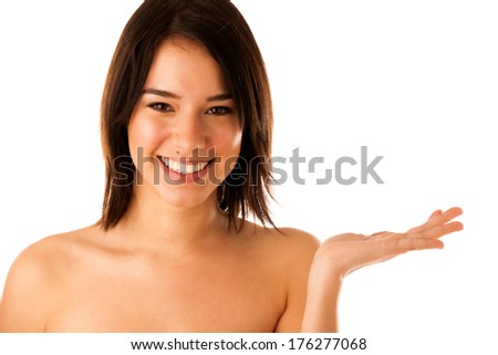 Beautiful young asian caucasian  girl holding her hand over cpyspace isolated over white background