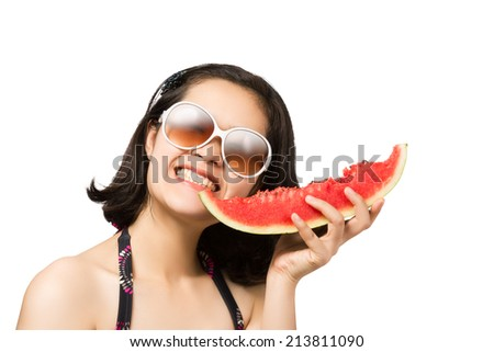 Beautiful young Asian girl eating watermelon with joy. isolated on white background. - stock photo