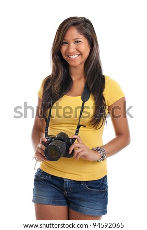 Beautiful young Asian girl photographer with camera isolated on white background - stock photo