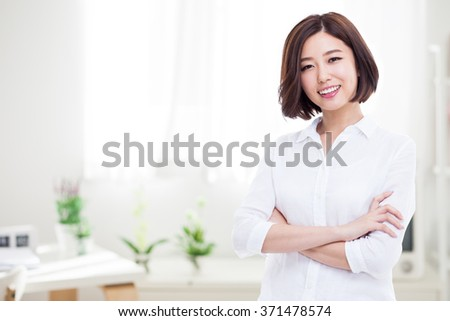 Beautiful young Asian Lady on home background. - stock photo