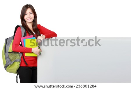 Beautiful young asian student holding empty board isolated over white background - stock photo
