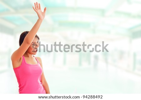 Beautiful young Asian woman call a friend in the background a train station or airport - stock photo