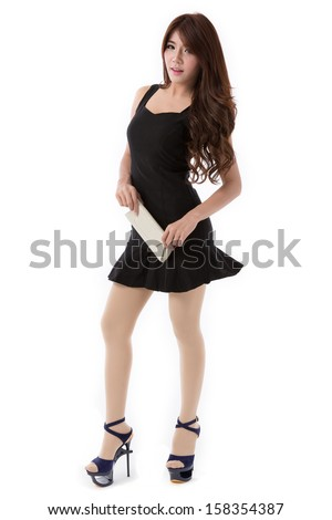 Beautiful young asian woman full body posing in classic skirt dress isolated on white background.