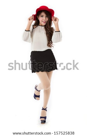 Beautiful young asian woman  full body posing in white blouse and black skirt with red had isolated on white background.