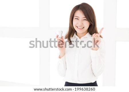 Beautiful young asian woman having a LED electric bulb - stock photo