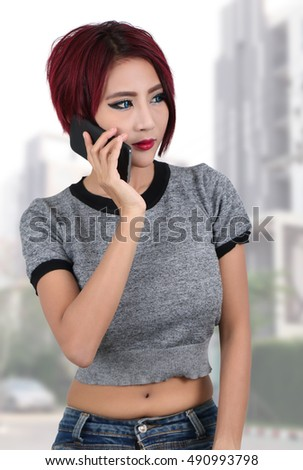 beautiful young asian woman holding smart phone