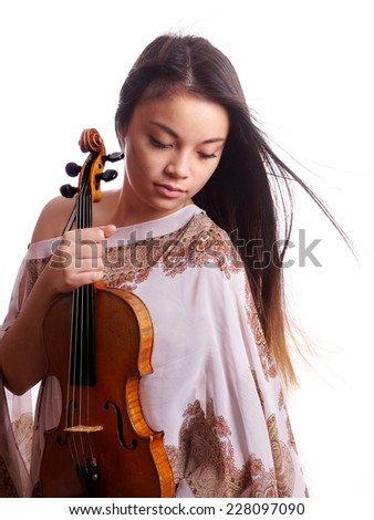 beautiful young asian woman holding violin music instrument - stock photo