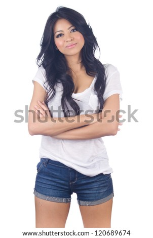 Beautiful young  asian woman in blue short jeans on white background - stock photo